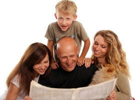 Family reading newspaper