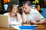 Couple are distressed while paying bills.