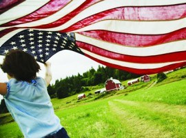 girl runs by barn with American flag montage