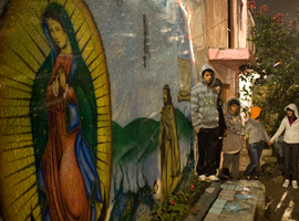Teens gather to pray at an image of our Lady of Guadalupe in Leon Mexico.  CNS Photo/David Maung.