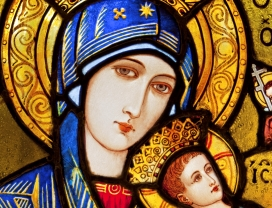 A detail of a Madonna from a stained glass window.  iStock image.