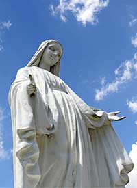 A statue of Mary overlooks the grounds of St. Jude Church in Mastic Beach, N.Y. CNS Photo/Gregory A. Shemitz