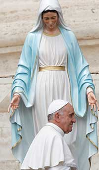 Pope Francis walks near a statue of Mary during his general audience in St. Peter's Square at the Vatican in this May 29, 2013. CNS Photo/Paul Haring