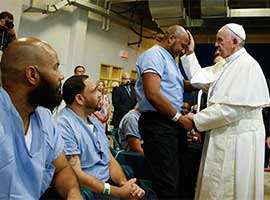 Pope Francis blesses an inmate at the Curran-Fromhold Correctional Facility in Philadelphia in September, 2015. CNS Photo/Paul Haring