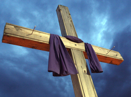 A simple wooden cross is draped in purple for Lent.  CNS Photo/Gregory A. Shemitz/Long Island Catholic.