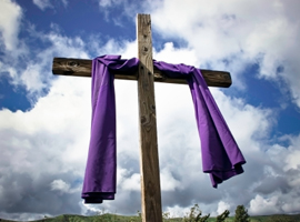 purple-draped-lenten-cross-montage-istock