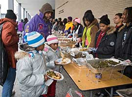 Two young girls receive food at an outdoor soup kitchen in Washington in late January, 2009. CNS photo/Jim West