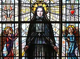 St. Frances Xavier Cabrini is pictured in a stained glass window at her shrine chapel in the Washington Heights section of New York City. CNS Photo/Gregory A. Shemitz
