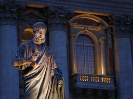 The great statue of St. Peter seen against the facade of his eponymus Basilica at the Vatican. CNS photo/Paul Haring