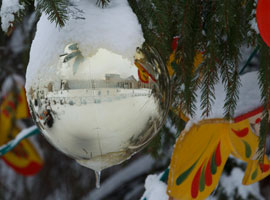 A rare 2012 snowfall reflected on an ornament in Vatican City. CNS Photo/Paul Haring.