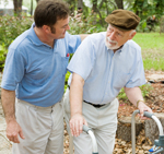 younger man helping older man