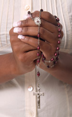 African American praying the rosary