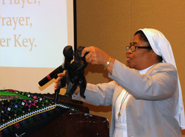 Sr. Joanna Okereke displays the SKU (Unity Symbol)