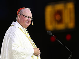 "Cardinal Timothy M. Dolan of New York smiles as he delivers the homily during the opening Mass of the ""Convocation of Catholic Leaders: The Joy of the Gospel in America"" July 1 in Orlando, Fla. (CNS photo/Bob Roller)"