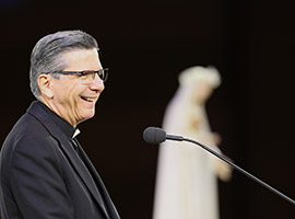 "Archbishop Gustavo Garcia-Siller of San Antonio smiles while speaking at a Marian devotion during the ""Convocation of Catholic Leaders: The Joy of the Gospel in America"" July 1 in Orlando, Fla. (CNS photo/Bob Roller)"