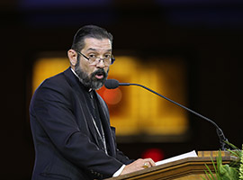 "Bishop Daniel Flores of Brownsville, Texas,, speaks during eucharistic adoration at the ""Convocation of Catholic Leaders: The Joy of the Gospel in America"" July 2 in Orlando, Fla. (CNS photo/Bob Roller)"