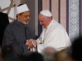 Pope Francis greets Sheik Ahmad el-Tayeb, grand imam of al-Azhar University, at a conference on international peace in Cairo in April 2017. CNS Photo/Paul Haring.