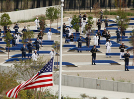 Flag flies at half-staff during memorial dedication at Pentagon on 9/11/2008.  CNS Photo/Paul Haring.