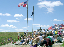 Tourists gather on a hillside at the temporary memorial site in Shanksville, Pa., where United Flight 93 crashed on 9/11/01. CNS photo/Ed Zelachoski, Catholic Accent.