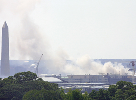 The smoldering Pentagon as seen from the roof of the U.S. Conference of Catholic Bishops on 9/11/01. CNS photo/Bob Roller.