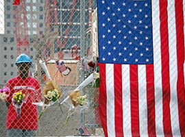 Worker looks at makeshift memorial at Ground Zero.  CNS Photo/Mary Knight.