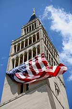 An huge U.S. flag flaps in the breeze as it hangs from the bell tower of the Basilica of the National Shrine of the Immaculate Conception in Washington, D.C.  CNS Photo/Bob Roller