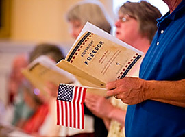 A man holds a program and U.S. flag during the opening Mass for the second annual Fortnight for Freedom observance on June 21. (CNS photo/Tom McCarthy Jr., Catholic Review)