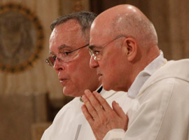 Philadelphia Archbishop Charles J. Chaput, OFM Cap and Archbishop Carlo Maria Vigano, apostolic nuncio to the United States, pray during the Fortnight for Freedom Closing Mass. (CNS Photo/Bob Roller)