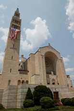 A huge flag drapes the Shrine of the Immaculate Conception. CNS Photo/Bob Roller