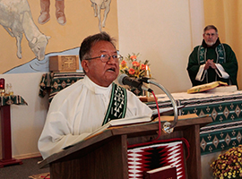 The late Deacon Marcellino Morris preaches at St Marys in Tohatchi NM. CNS Photo/Bob Roller