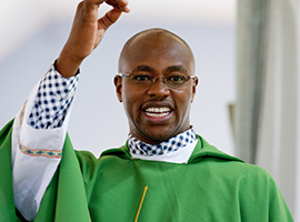 Father Moses Kago preaches St. Joseph's Church 2-2011 in Mutungulu, Kenya. (CNS photo/Nancy Wiechec)