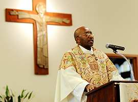 Father Paul Gitau preaches at St. Bridgets in Rochester NY. CNS Photo/Mike Crupi/Catholic Courie