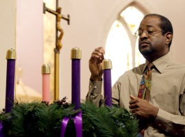 Joe Brooks lights the first candle of the Advent wreath at St. Josephs Catholic Church in Alexandria Va.   CNS photo/Nancy Phelan Wiechec