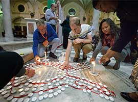 Participants of the the 2016 International AIDS Conference light candles at at the Roman Catholic Emmanuel Cathedral in Durban, South Africa, in July 2016. CNS photo/Paul Jeffrey