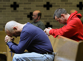 Men praying (CNS photo/Gregory A. Shemitz, Long Island Catholic)